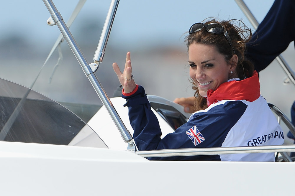 Description of . Catherine, Duchess of Cambridge waves to a British competitor during the Women's Laser Radials race on Day 10 of the London 2012 Olympic Games at the Weymouth & Portland Venue at Weymouth Harbour on August 6, 2012 in Weymouth, England. Kate Middleton ranked as Google's second most searched trending person of 2012. Her name ranked sixth in searches overall. (Photo by Pascal Le Segretain/Getty Images)