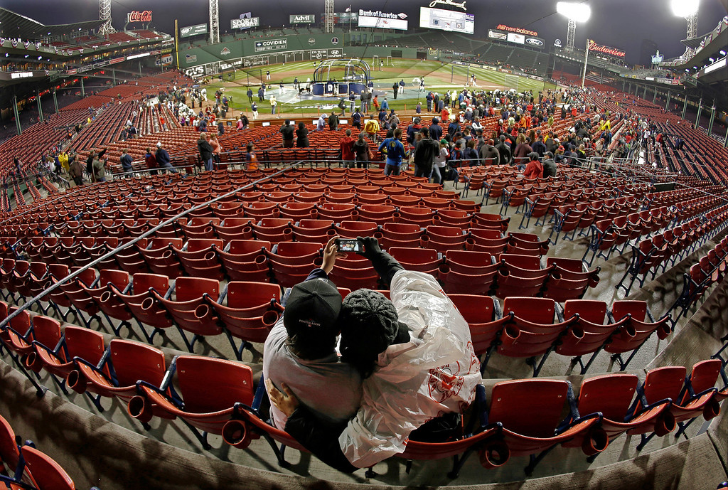 . Cathy Vetters and son John take a photo of themselves with a camera phone before Game 1 of the American League baseball championship series between the Boston Red Sox and the Detroit Tigers at Fenway Park, Saturday, Oct. 12, 2013, in Boston. (AP Photo/Charlie Riedel)