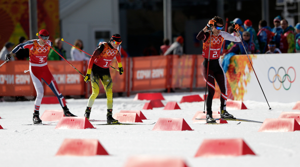 . Norway\'s Magnus Hovdal Moan, Germany\'s Eric Frenzel and Austria\'s Lukas Klapfer, from left, compete during the cross-country portion of the Nordic combined Gundersen large hill team competition at the 2014 Winter Olympics, Thursday, Feb. 20, 2014, in Krasnaya Polyana, Russia. (AP Photo/Matthias Schrader)