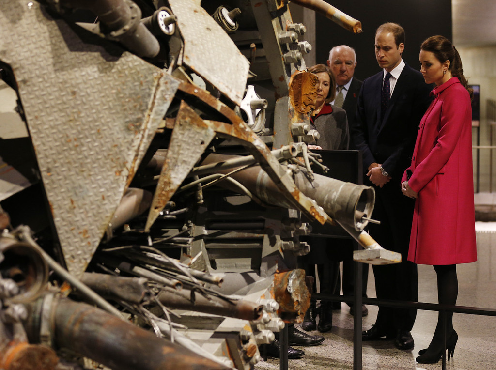 . Prince William, Duke of Cambridge and Catherine, Duchess of Cambridge are shown the remains of an aerial which once stood atop one of the twin towers during a visit the National September 11 Memorial & Museum on December 09, 2014 in New York City.  The couple, who are traveling without their son Prince George, are on a three-day US east coast visit. This is the Duke and Duchess\' first official visit to New York City. (Photo by Jonathan Brady - Pool/Getty Images)