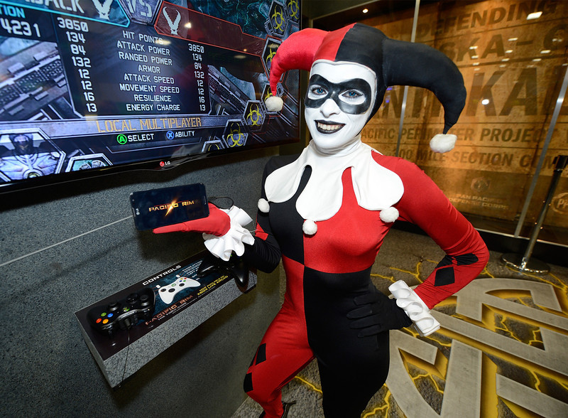 . The infamous Harley Quinn character from Batman checks out the latest LG smartphones and smart TVs at the Legendary Entertainment booth at Comic-Con International 2013, on Thursday, July, 18, 2013 in San Diego. (Photo by Jeff Bottari/Invision for LG/AP Images)