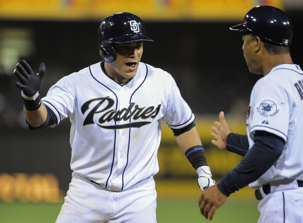 . SAN DIEGO, CA - JULY 9:  Everth Cabrera #2 of the San Diego Padres is congratulated by Dave Roberts #10 after he hit a single during the seventh inning of a baseball game against the Colorado Rockies at Petco Park on July 9, 2013 in San Diego, California.  (Photo by Denis Poroy/Getty Images)