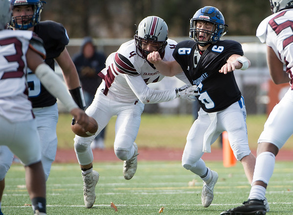 11/28/19 Wesley Bunnell | StaffrrPlainville football defeated Farmington on Thanksgiving morning at Plainville High School. Christian Collin (6) is stripped of the ball for a Plainville turnover.
