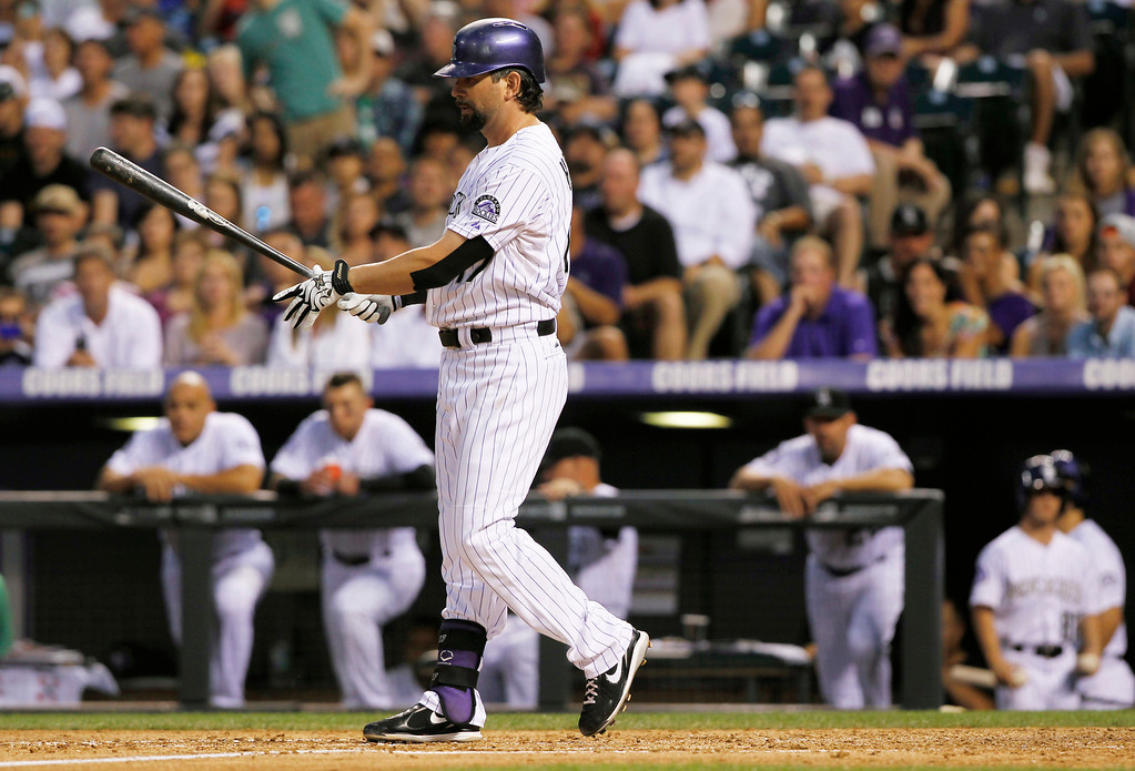 . Colorado Rockies\' Todd Helton reacts after striking out against the Cincinnati Redsto end the fourth inning of a baseball game in Denver on Saturday, Aug. 31, 2013. Helton is one hit shy of reaching 2,500 hits in his career. (AP Photo/David Zalubowski)