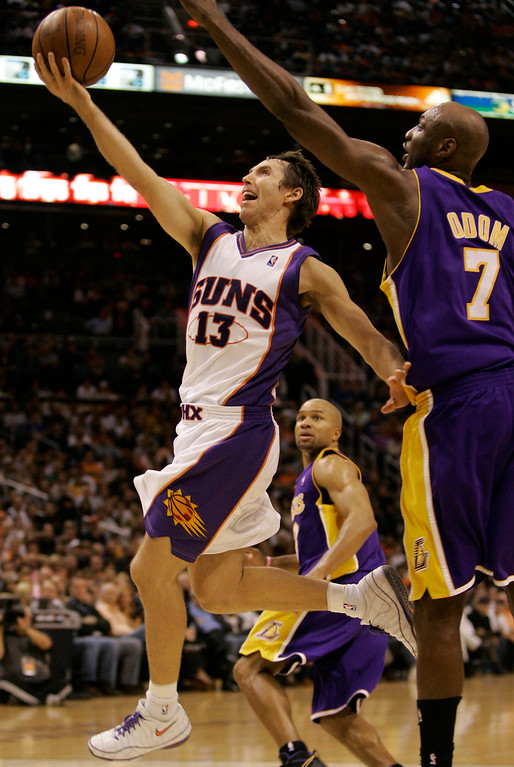 . Phoenix Suns\' Steve Nash (13) drives to the basket past Los Angeles Lakers\' Lamar Odom during the fourth quarter of an NBA basketball game Thursday, Nov. 20, 2008 in Phoenix. (AP Photo/Matt York)