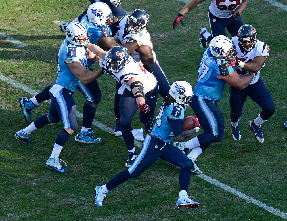 . Tennessee Titans running back Chris Johnson (28) runs eleven yards for a touchdown against the Houston Texans in the third quarter of an NFL football game on Sunday, Dec. 29, 2013, in Nashville, Tenn. (AP Photo/Mark Zaleski)