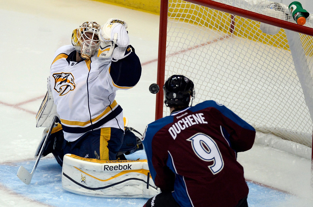 . Colorado Avalanche center Matt Duchene (9) watches the puck sail by Nashville Predators goalie Carter Hutton (30) for a goal on a shot by Colorado Avalanche center Ryan O\'Reilly (90) in the second period November 6, 2013 at Pepsi Center. (Photo by John Leyba/The Denver Post)