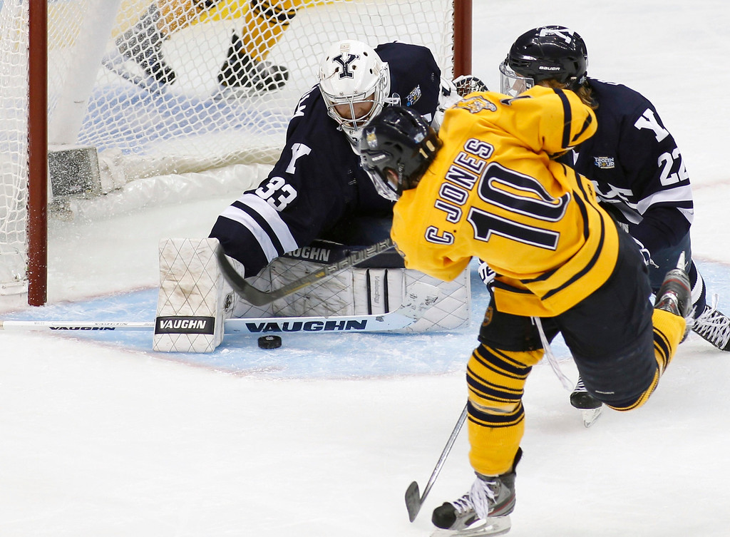 . Yale goalie Jeff Malcolm (33) blocks a shot by Quinnipiac\'s Connor Jones (10) in the first period of their men\'s NCAA college ice hockey championship game in Pittsburgh, Pennsylvania, April 13, 2013. REUTERS/ Jason Cohn