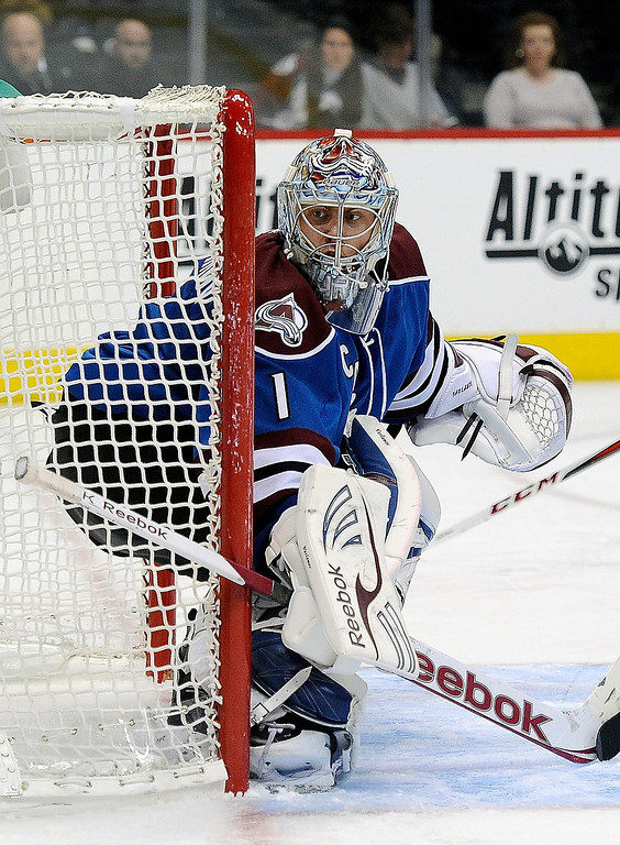 . Colorado Avalanche goalie Semyon Varlamov, of Russia, watches the puck in the second period of an NHL hockey game against the San Jose Sharks on Sunday, March 10, 2013, in Denver.  (AP Photo/Chris Schneider)