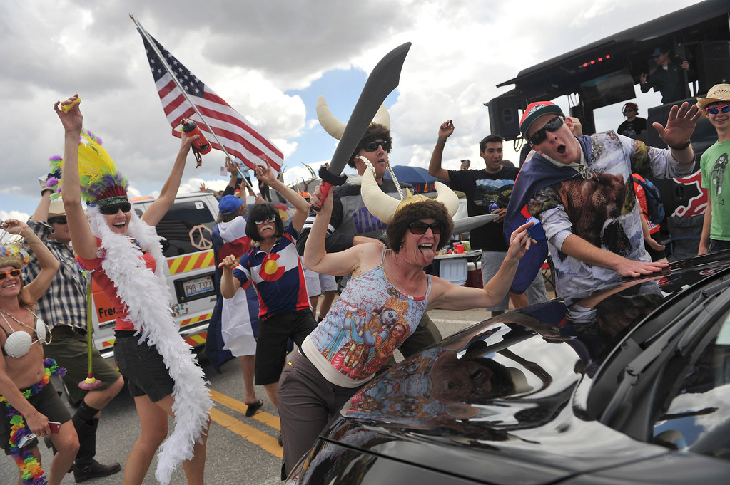 . Fans celebrate as the cyclists make their way over Independence Pass during stage 2. (Photo By Hyoung Chang/The Denver Post)