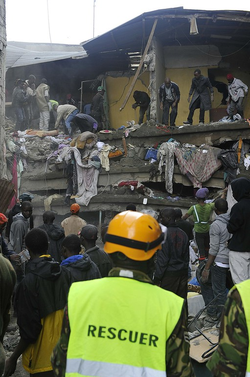. Rescue workers look for survivors after a building collapsed in Nairobi on April 30, 2016.  / AFP PHOTO / SIMON  MAINA/AFP/Getty Images
