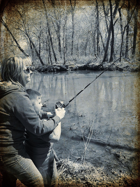 Kim and Jonah fishing on the Neches River on Chandler, TX