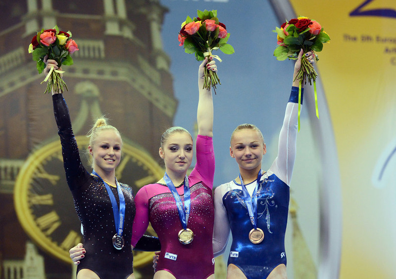 . (L-R) Sweden\'s Jonna Adlertg, Russia\'s Aliya Mustafina and Maria Paseka celebrate on the podium during the women\'s apparatus artistic gymnastics finals during the 5th European Men\'s and Women\'s Artistic Gymnastic Individual  Championships in Moscow on April  20, 2013. Russia\'s Aliya Mustafina took the first place, Sweden\'s Jonna Adlertg took the second place and Russia\'s Maria Paseka took the third place. NATALIA KOLESNIKOVA/AFP/Getty Images