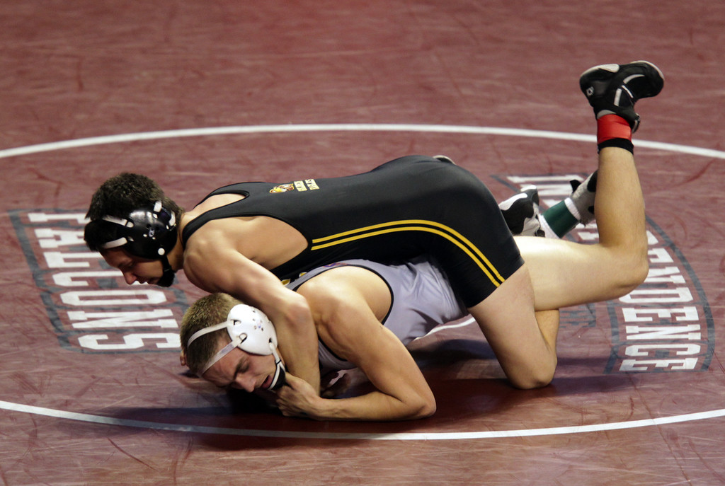 . Oroville\'s Michael Ripley, right, wrestles Clovis West\'s Chris Lane in a 132-pound second round match during the California Interscholastic Federation wrestling championships in Bakersfield, Calif., on Friday, March 1, 2013. (Anda Chu/Staff)