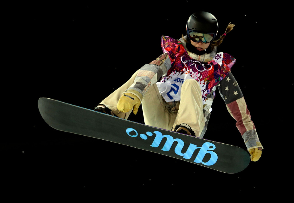 . United States\' Kaitlyn Farrington competes on her way to win the women\'s snowboard halfpipe final at the Rosa Khutor Extreme Park, at the 2014 Winter Olympics, Wednesday, Feb. 12, 2014, in Krasnaya Polyana, Russia. (AP Photo/Felipe Dana)