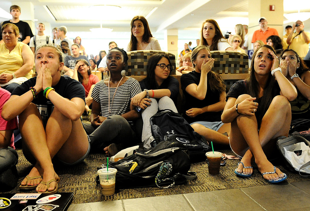 . Penn State students and others react to the sanctions the NCAA announced against Penn State in the HUB on the campus of Penn State on July 23, 2012 in State College, Pennsylvania. As an outcome of the university\'s mishandling of the allegations of child-sexual abuse by former coach Jerry Sandusky, Penn State was fined $60 million, was stripped of all its football wins from 1998 through 2011, barred from postseason games for four years, and lost 20 total scholarships annually for four seasons.  (Photo by Patrick Smith/Getty Images)