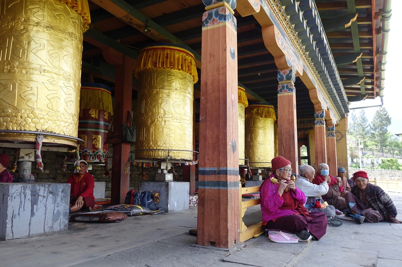 elders group by the prayer wheels at the National Memorial Chorten in Thimphu