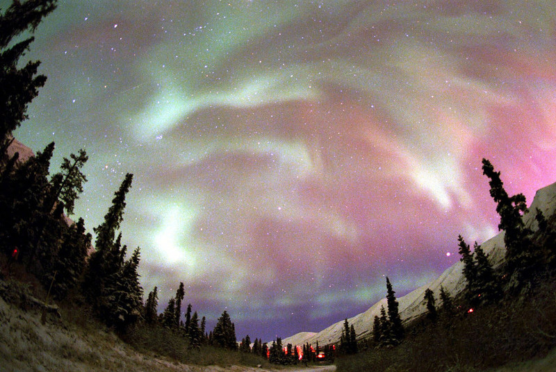 . The northern lights dance and swirl over the Chuguch Mountains near Anchorage, Alaska, in this undated file photo. Astronomy buffs and scientists are using satellite data via the Internet to get a good look at the northern lights. (AP Photo/Evan Steinhauser Photography, File)