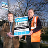 Greg McLaughlin, Translink District Manager for Newry, left, helps Paddy Arthurs install new bus stop signs.The new signage has been erected in advance of the launch of new, improved Ulsterbus services in the Newry area as part of Translink'sthree-yearUlsterbus Strategic Review.<br /> 07W08N146