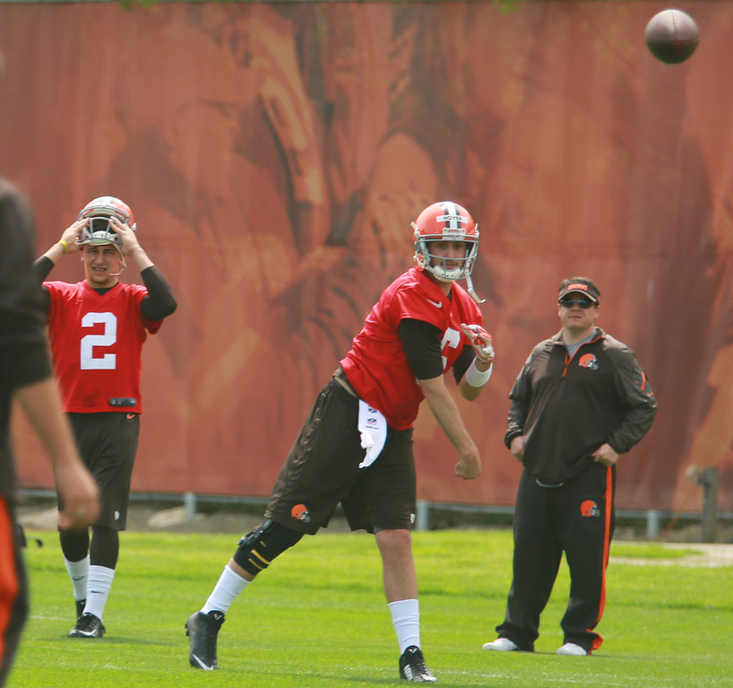 . Michael Allen Blair/Digital First Media Browns\' quarterback Brian Hoyer take some reps as rookie quarterback Johnny Manziel looks on at left, during organized team activities on May 21 in Berea.