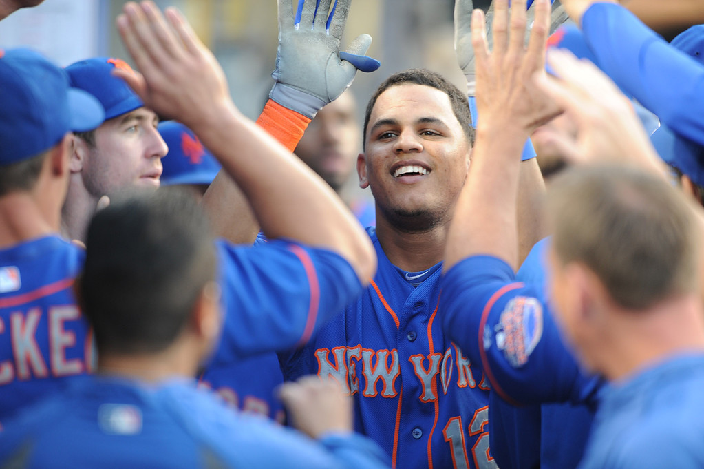 . Mets #12 Juan Lagares is congratulated on his first inning homer. The Dodgers played the New York Mets in a game at Dodger Stadium in Los Angeles, CA. 8/13/2013(John McCoy/LA Daily News)