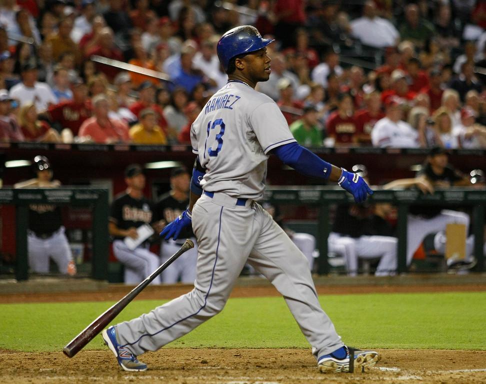 . Los Angeles Dodgers shortstop Hanley Ramirez (13) hits an RBI single in the fifth inning during a baseball game against the Arizona Diamondbacks on Monday, July 8, 2013, in Phoenix. (AP Photo/Rick Scuteri)
