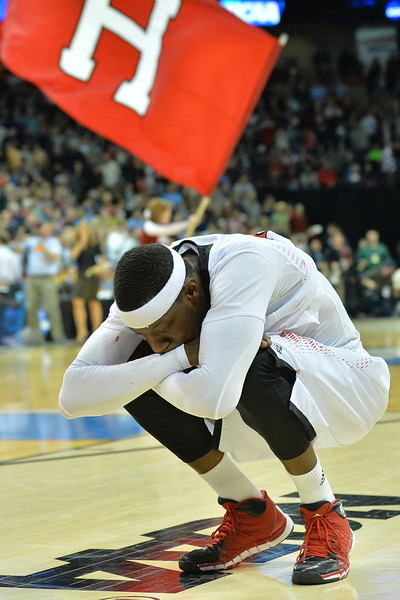 March 20, 2014: Cincinnati Bearcats forward Justin Jackson (5) reacts to his team's loss after a second round game of the NCAA Division I Men's Basketball Championship between the 5-seed Cincinnati Bearcats and the 12-seed Harvard Crimson at Spokane Arena in Spokane, Wash. Harvard defeated Cincinnati 61-57.