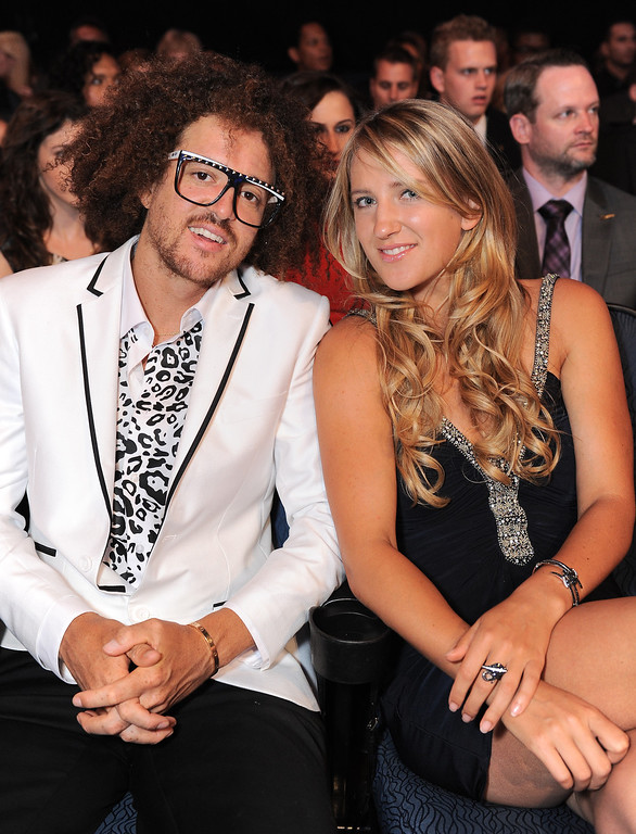 . Redfoo, of musical duo LMFAO, left, and tennis player Victoria Azarenka pose in the audience at the ESPY Awards on Wednesday, July 17, 2013, at Nokia Theater in Los Angeles. (Photo by Jordan Strauss/Invision/AP)