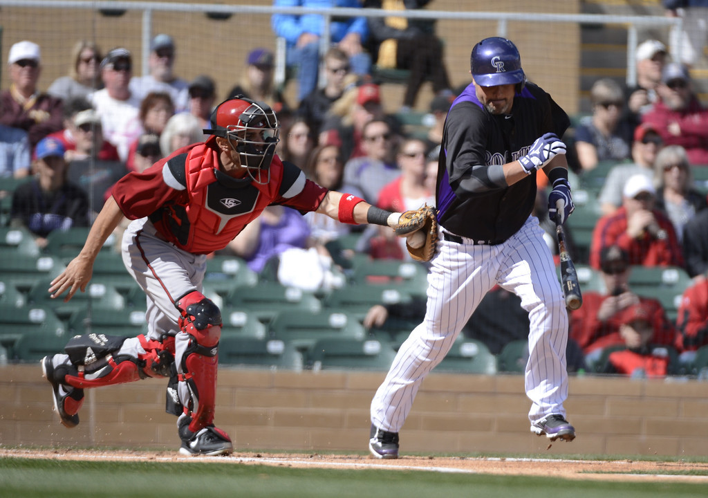. SCOTTSDALE, AZ. - FEBRUARY 24: Ramon Hernandez (55) of the Colorado Rockies gets tagged out by Wil Nieves (27) of the Arizona Diamondbacks February 24, 2013 in Scottsdale. (Photo By John Leyba/The Denver Post)