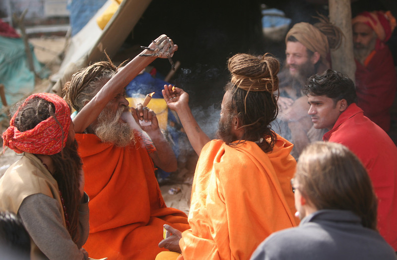This sadhu may have held his arm in the air for years if not decades. Smoking ganja might help with the pain.