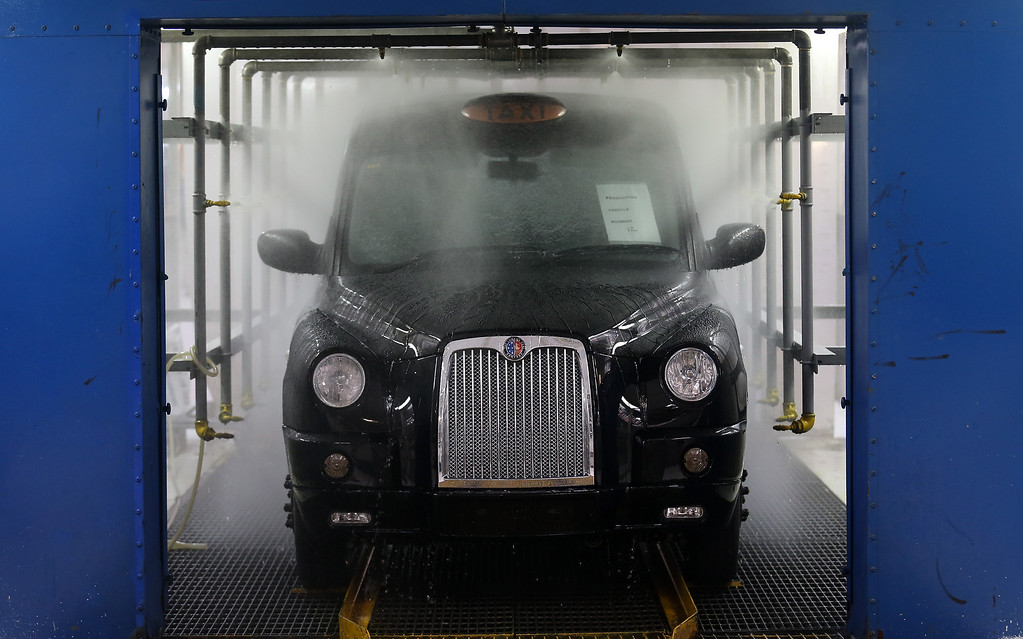 . A completed TX4 (Euro 5) London Taxi is tested for leaks inside the factory of The London Taxi Factory on September 11, 2013 in Coventry, England.  (Photo by Matt Cardy/Getty Images)