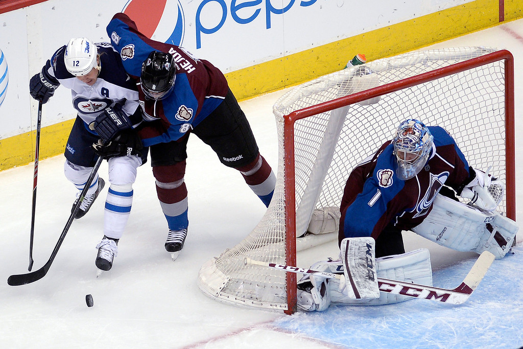 . Jan Hejda (8) of the Colorado Avalanche gets physical with Olli Jokinen (12) of the Winnipeg Jets as Semyon Varlamov (1) of the Colorado Avalanche tends the net during the first period. (Photo by AAron Ontiveroz/The Denver Post)