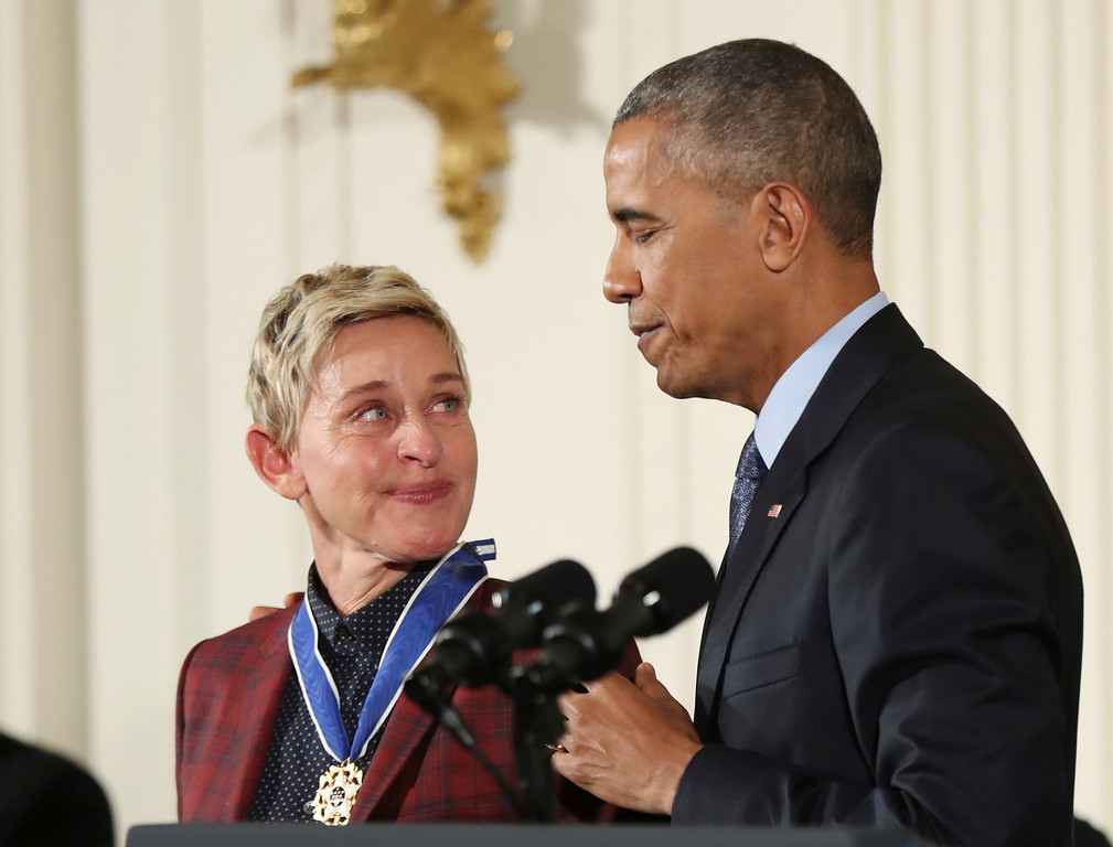 . Actress, comedian, and talk show host Ellen DeGeneres, glances at President Barack Obama as she is presented the Presidential Medal of Freedom during a ceremony in the East Room of the White House Tuesday, Nov. 22, 2016, in Washington. Obama is recognizing 21 Americans with the nation\'s highest civilian award, including giants of the entertainment industry, sports legends, activists and innovators. (AP Photo/Manuel Balce Ceneta)