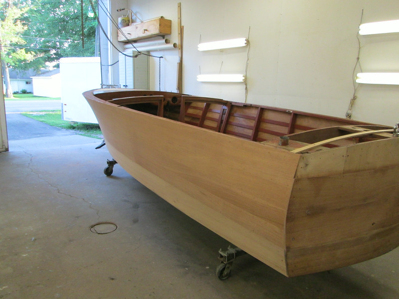 Rear port view of the hull right side up with new side planks install and sanded.