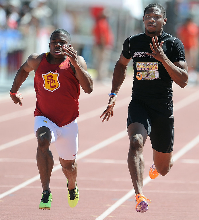 . Romontay McClain of Azusa Pacific runs past BeeJay lee of USC as he finished third in the 100 meter dash olympic Development elite during the Mt. SAC Relays in Hilmer Lodge Stadium on the campus of Mt. San Antonio College on Saturday, April 20, 2012 in Walnut, Calif.    (Keith Birmingham/Pasadena Star-News)