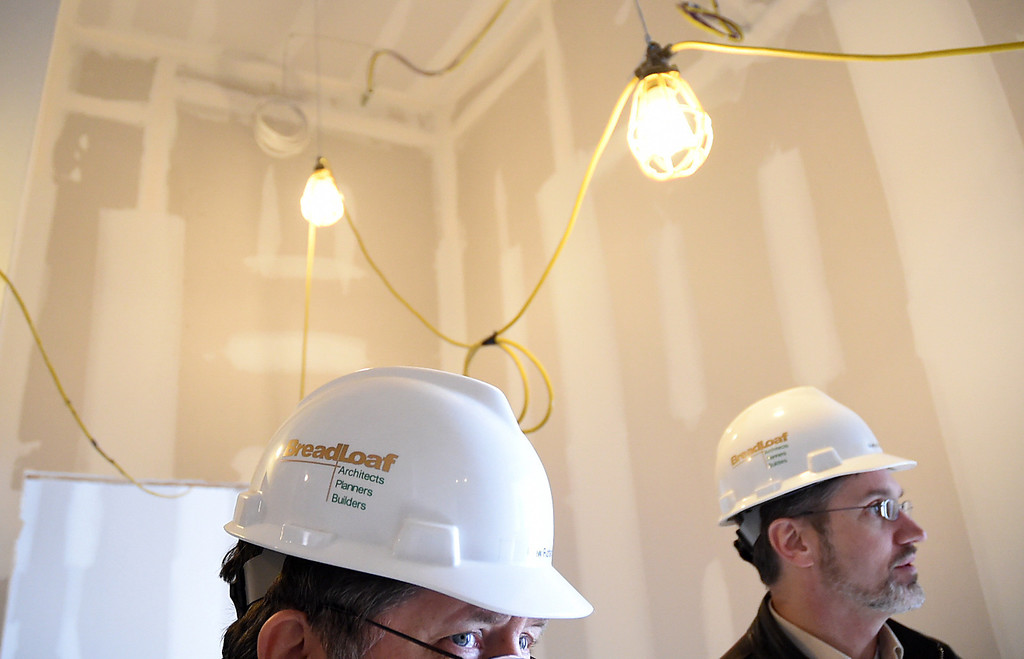 . Kayla Rice/Reformer Bob Stevens of Mesabi LLC gives members of the media a tour of the Brooks House to show the progress of the historic building\'s re-construction on Thursday afternoon.