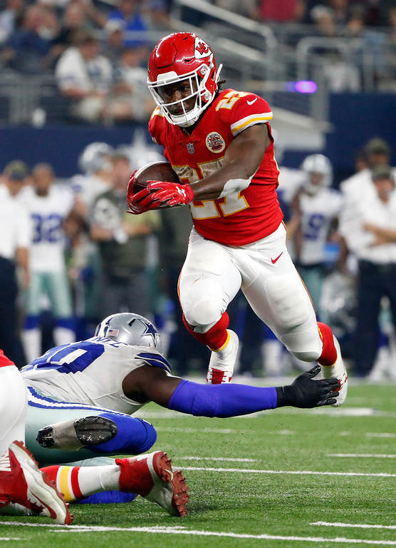 . Dallas Cowboys defensive end DeMarcus Lawrence (90) is unable to stop Kansas City Chiefs running back Kareem Hunt (27) from advancing the ball on a run in the second half of an NFL football game, Sunday, Nov. 5, 2017, in Arlington, Texas. (AP Photo/Michael Ainsworth)