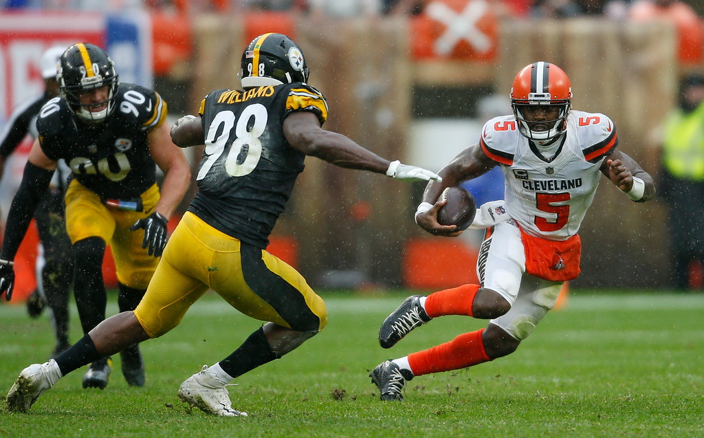 . Cleveland Browns quarterback Tyrod Taylor (5) scrambles against Pittsburgh Steelers linebacker Vince Williams (98) during the first half of an NFL football game, Sunday, Sept. 9, 2018, in Cleveland. (AP Photo/Ron Schwane)