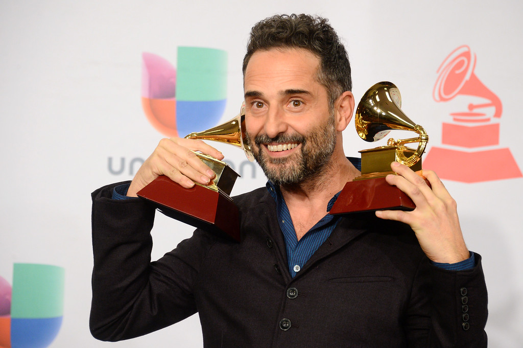 """. Jorge Drexler poses in the press room with the awards for record of the year for \""""Universos Paralelos\"""" and best singer/songwriter album for \""""Bailar En La Cueva\"""" at the 15th annual Latin Grammy Awards at the MGM Grand Garden Arena on Thursday, Nov. 20, 2014, in Las Vegas. (Photo by Al Powers/Invision/AP)"""