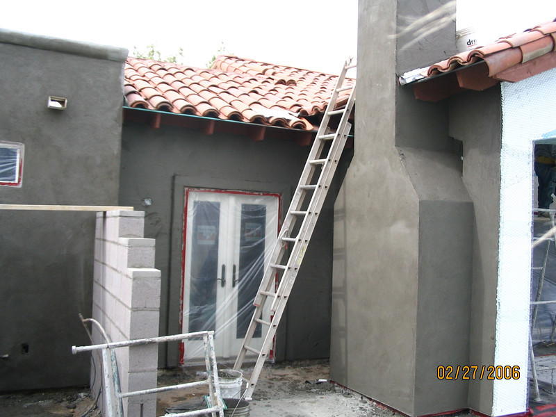 The first coat of the new stucco has been applied to this end of the back of the house.