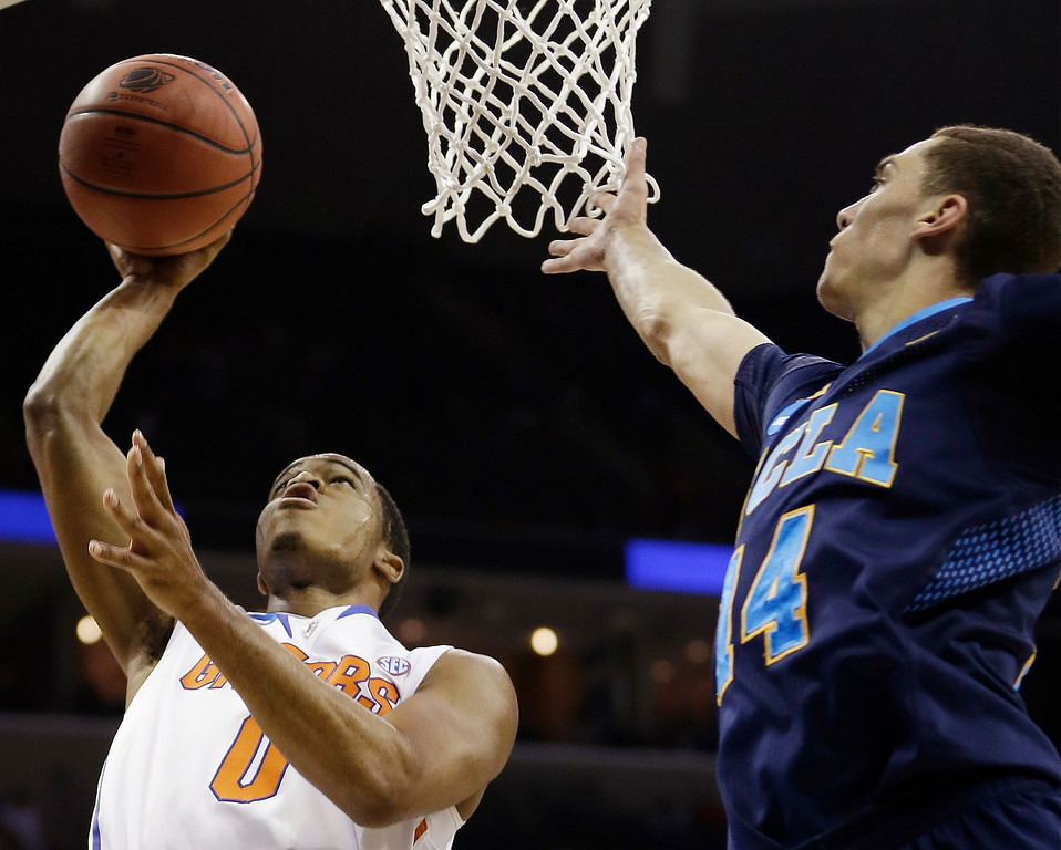 . Florida Kasey Hill shoots as UCLA guard Zach LaVine (14) looks on during the first half in a regional semifinal game at the NCAA college basketball tournament, Thursday, March 27, 2014, in Memphis, Tenn. (AP Photo/Mark Humphrey)