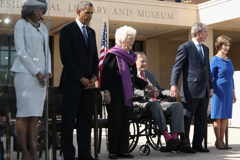 Description of . First lady Michelle Obama, U.S. President Barack Obama, former first lady Barbara Bush, former President George H.W. Bush, former President George W. Bush and former first lady Laura Bush attend the opening ceremony of the George W. Bush Presidential Center April 25, 2013 in Dallas, Texas. The Bush library, which is located on the campus of Southern Methodist University, with more than 70 million pages of paper records, 43,000 artifacts, 200 million emails and four million digital photographs, will be opened to the public on May 1, 2013. The library is the 13th presidential library in the National Archives and Records Administration system.  (Photo by Alex Wong/Getty Images)