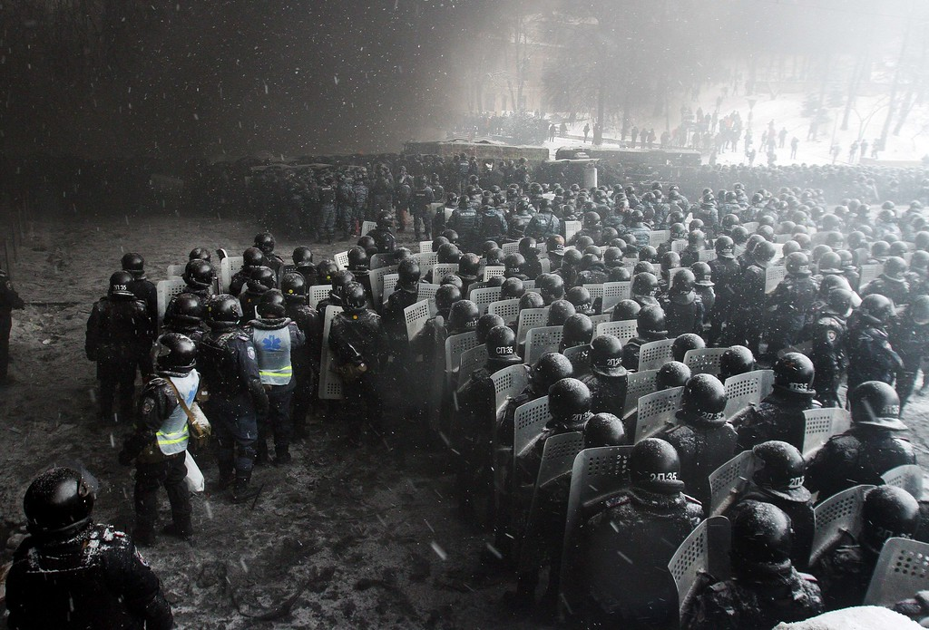 . Riot police officers gather as they clash with protestors in the center of Kiev on January 22, 2014. Ukrainian police today stormed protesters\' barricades in Kiev as violent clashes erupted and activists said that one person had been shot dead by the security forces. Total of two activists shot dead during clashing. The move by police increased tensions to a new peak after two months of protests over President Viktor Yanukovych\'s failure to sign a deal for closer ties with the EU. ANATOLII BOIKO/AFP/Getty Images
