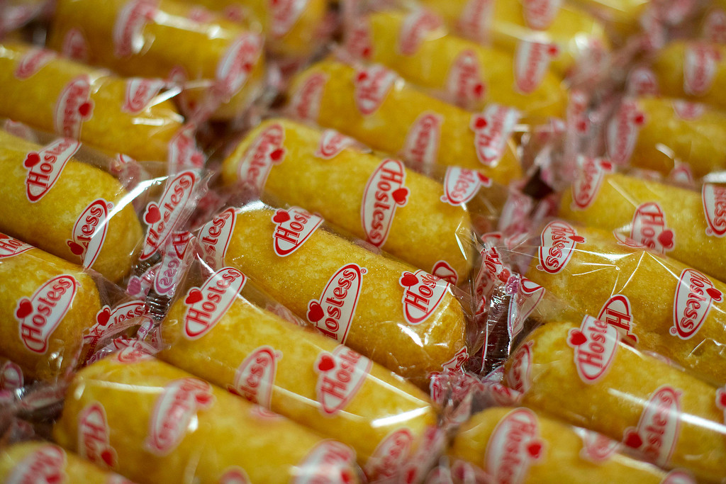 . Hostess Brands LLC Twinkies snack cakes sit in a tray in the packaging area of a Hostess bakery in Schiller Park, Illinois, U.S., on Monday, July 15, 2013. Photographer: Daniel Acker/Bloomberg
