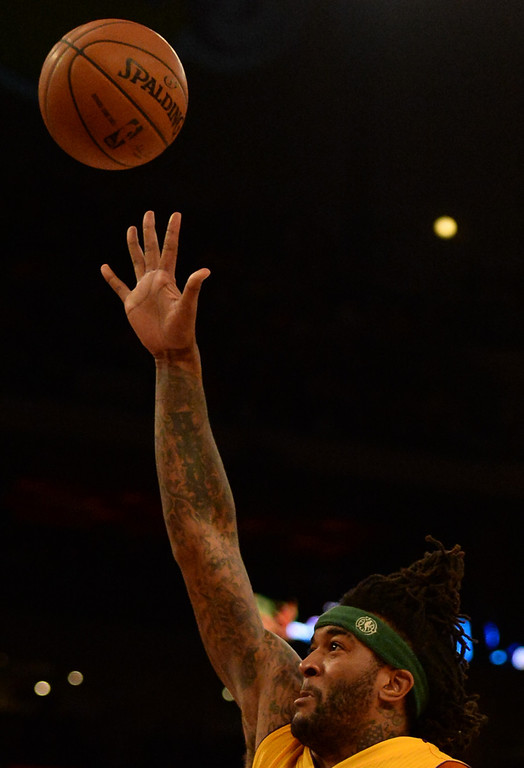 . Los Angeles Lakers forward Jordan Hill shoots in the first quarter during an NBA basketball game against Dallas Mavericks in Los Angeles, Calif., on Friday, April 4, 2014.  (Keith Birmingham Pasadena Star-News)
