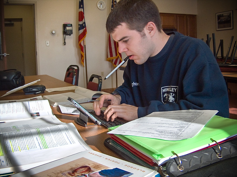 Caleb studding for paramedic midterm at Hinckley Fire Department with Tungsten T3 Palm Pilot