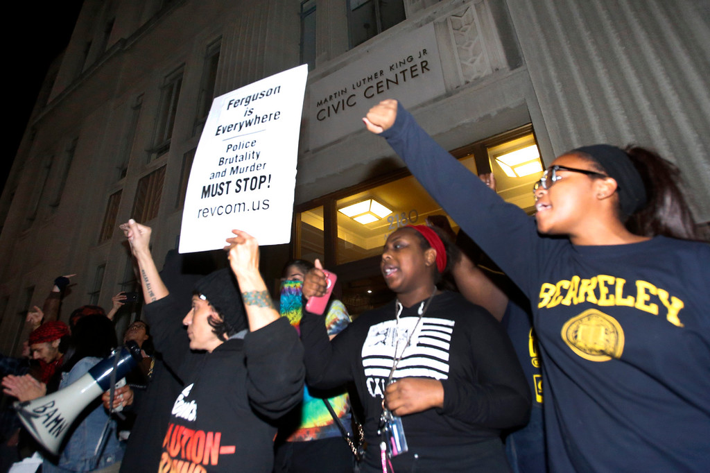 . Protesters use the steps of City Hall in Berkeley, Calif., Sunday evening, Dec. 7, 2014, to speak out against the killings of two unarmed black men by police in Ferguson, Mo., and New York. (Karl Mondon/Bay Area News Group)