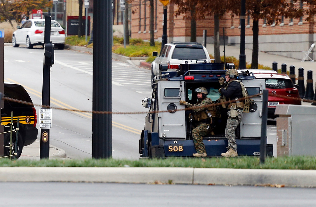 . Members of the Columbus SWAT team work the scene around a parking garage after reports of a shooting on the campus of Ohio State University on Monday, Nov. 28, 2016, in Columbus, Ohio. (AP Photo/Jay LaPrete)