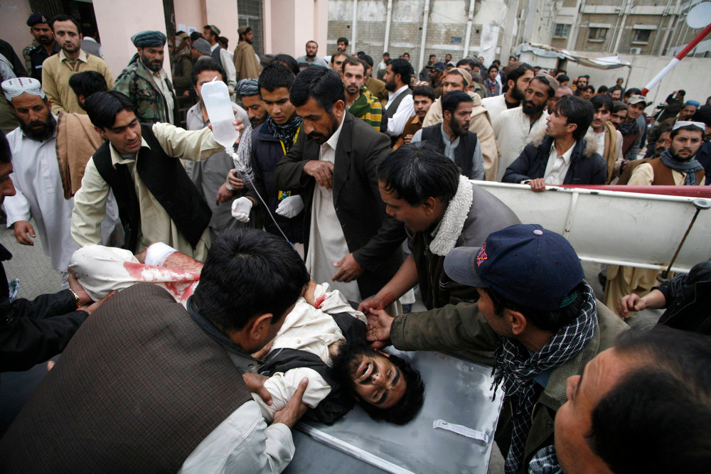 . People wheel a man who was injured by a bomb explosion, at a hospital in Quetta January 10, 2013. A bomb blast in a crowded marketplace killed 11 people and injured more than 40 in Pakistan\'s eastern provincial capital of Quetta on Thursday and a local militant group claimed responsibility, police said. REUTERS/Naseer Ahmed