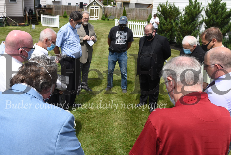 Harold Aughton/Butler Eagle: A group of pastors pray prior the prayer vigil in Mars, Wednesday, June 17, 2020.